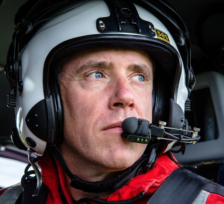 paramedic in helicopter with flight helmet