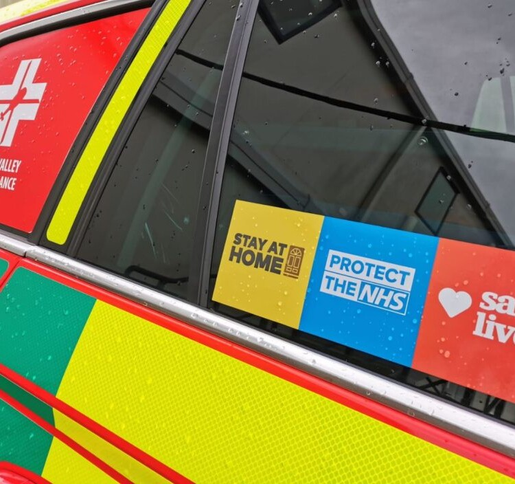 stay at home, protect the nhs, save lives sticker on critical care response vehicle